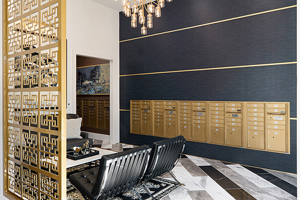 Gold Mailboxes in Lobby area with seating